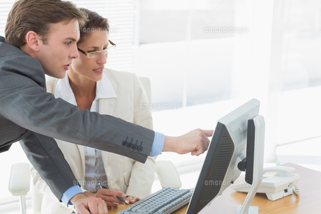 Business couple using computer at office desk FYI00000009
