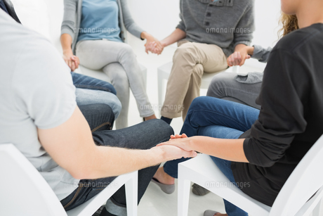 Group therapy in session sitting in a circle FYI00000018