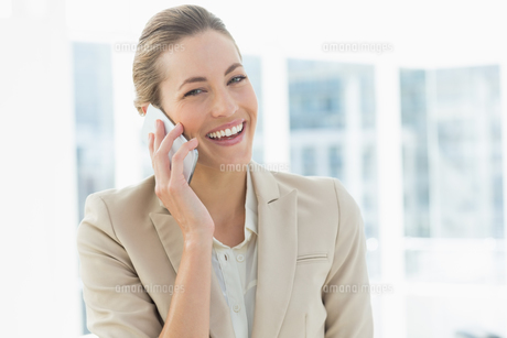 Portrait of a young businesswoman using mobile phone FYI00000067