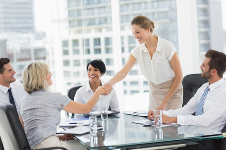 Executives shaking hands during a business meeting FYI00000074
