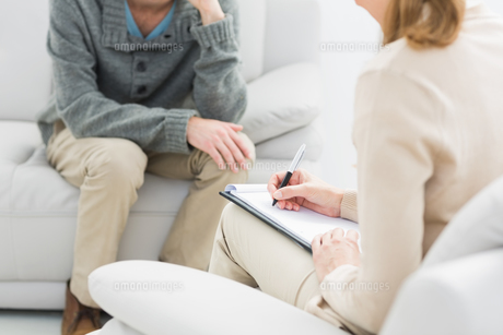 Young man in meeting with a psychologist FYI00000100