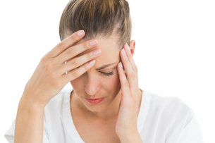 Woman having a headache with her head in her handsの素材 [FYI00000274]