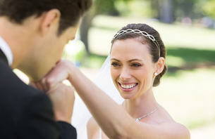 Groom kissing on hand of bride FYI00000735