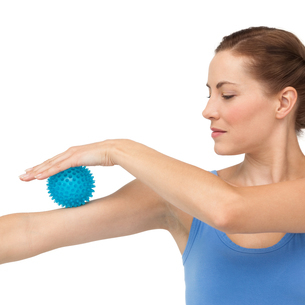 Portrait of a young woman holding stress ball on arm FYI00001614