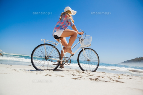 Pretty blonde on a bike ride at the beach FYI00002067