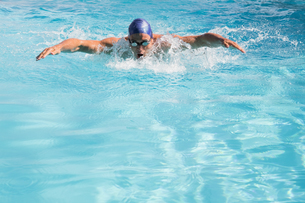 Fit swimmer doing the butterfly stroke in the swimming pool FYI00002200