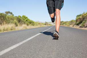 Fit man jogging on the open road FYI00002463