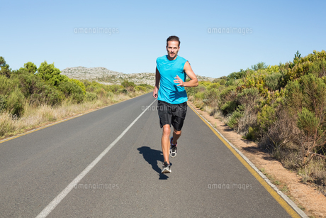 Fit man jogging on the open road FYI00002471
