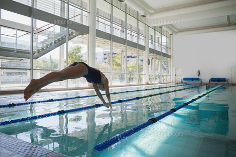 Fit swimmer diving into the pool at leisure center FYI00002927