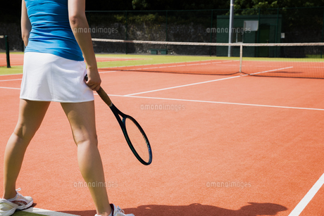 Tennis player standing on court FYI00002936