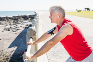 Fit mature man warming up on the pier FYI00003003