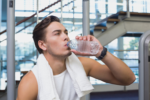 Fit man taking a break from working out FYI00003300