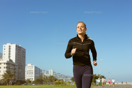 Fit blonde jogging on the pier FYI00003347