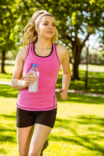 Fit blonde jogging in the park FYI00003628