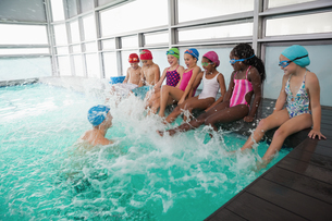Cute swimming class in pool with coach FYI00004380