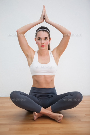 Fit brunette doing yoga at home FYI00004952