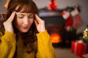 Redhead getting a headache on christmas day FYI00005035