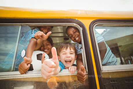 Cute pupils smiling at camera in the school bus FYI00005519