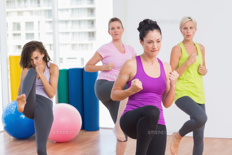 Women practicing kickboxing at fitness studio FYI00005792