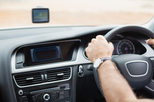 Man driving with satellite navigation system FYI00005946