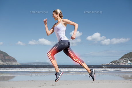 Highlighted leg bones of jogging woman on beach FYI00006268