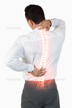 Highlighted spine of man with back pain FYI00006279