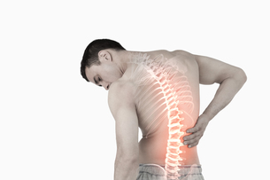 Highlighted spine of man with back pain FYI00006282