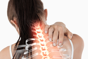 Highlighted spine of woman with neck pain FYI00006283