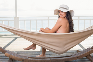 Pretty brunette relaxing on a hammock FYI00006301