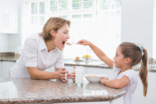 Mother and daughter having breakfast FYI00006558