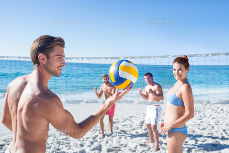 Friends playing volleyball FYI00007037