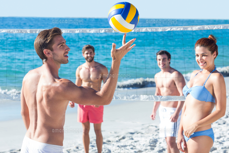 Friends playing volleyball FYI00007041