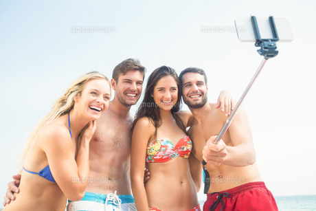 group of friends in swimsuits taking a selfie FYI00007134
