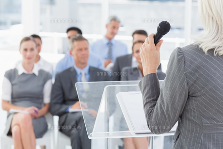 Businesswoman doing speech during meeting FYI00007544
