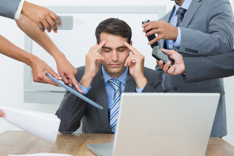 Worried businessman with head in hands FYI00007573