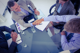 Business team shaking hands at meeting FYI00007681