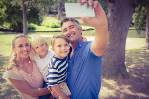 Happy family taking a selfie in the park FYI00007945