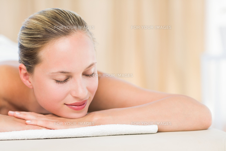 Peaceful blonde lying on towel FYI00008180