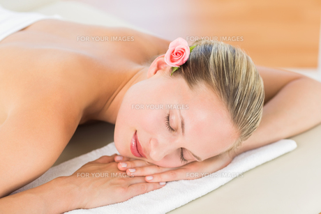 Peaceful blonde lying on towel FYI00008185