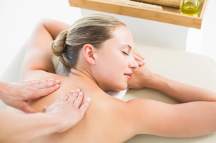 Woman enjoying a back massage FYI00008195