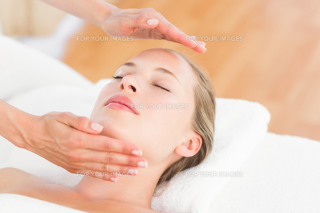 Calm woman receiving reiki treatment FYI00008208