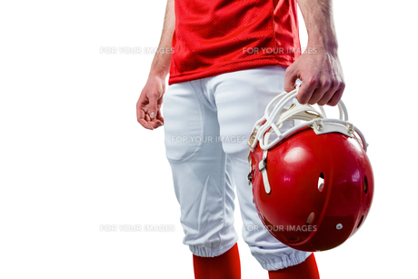 An american football player taking his helmet on her hand FYI00008689