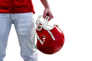 An american football player taking his helmet on hand FYI00008691