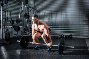 Muscular man lifting a barbell FYI00009212