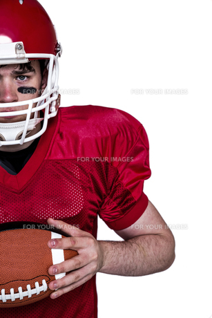 American football player holding a ballの素材 [FYI00009632]