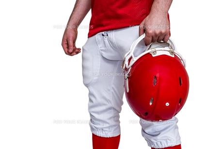 American football player holding a helmet FYI00009633