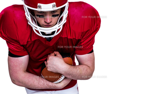 American football player running with the ball FYI00009641