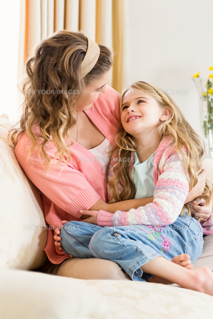 Mother and daughter smiling together FYI00010055