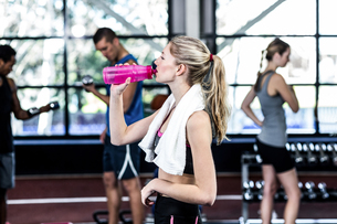 Blonde woman drinking water after working out FYI00010098