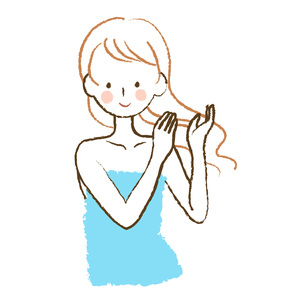 髪をなでる女性の素材 [FYI00075945]